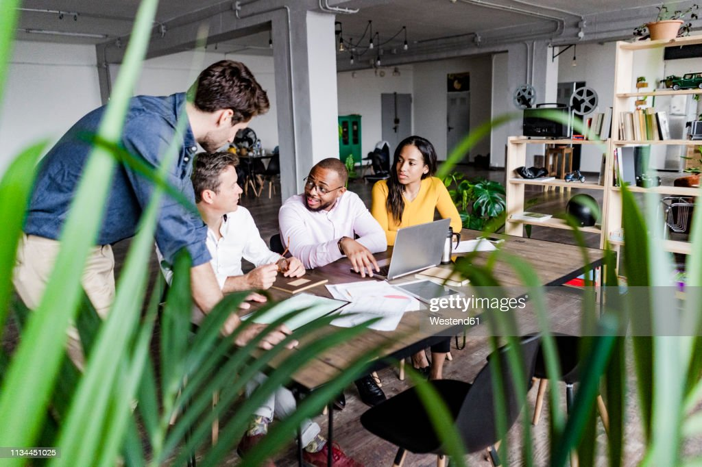 Confident business team having a meeting in loft office : Stock Photo