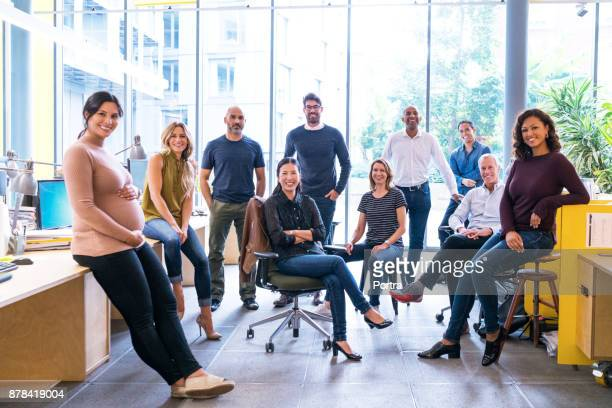 Confident business team in creative office