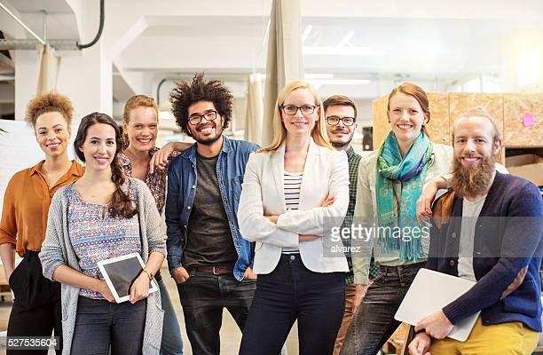 Confident business team smiling in office