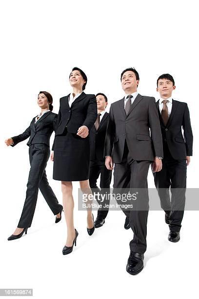 Confident business team walking forward