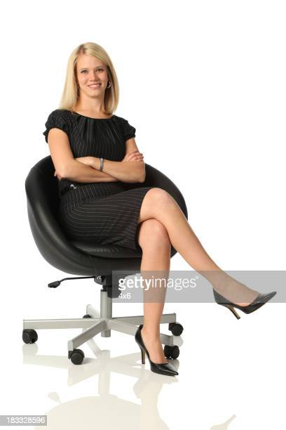 Legs Crossed At Knee Stock Photos And Pictures Getty Images