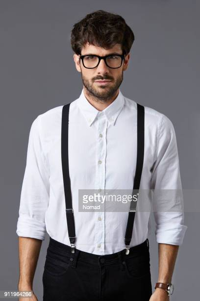confident businessman against gray background - suspenders stock pictures, royalty-free photos & images