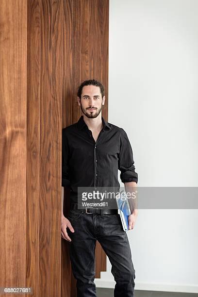 Confident businessman holding folders