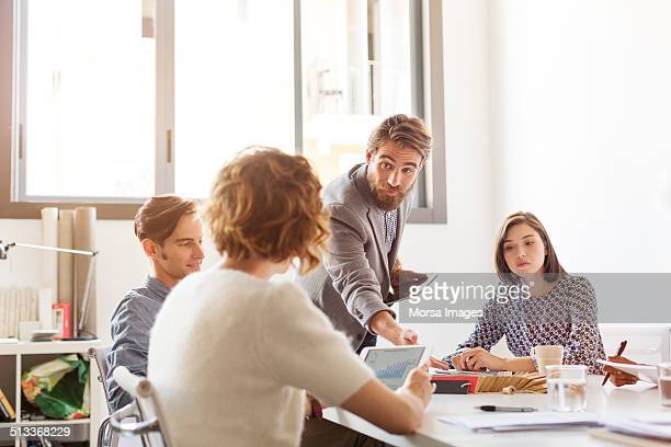 Confident businessman in board room meeting