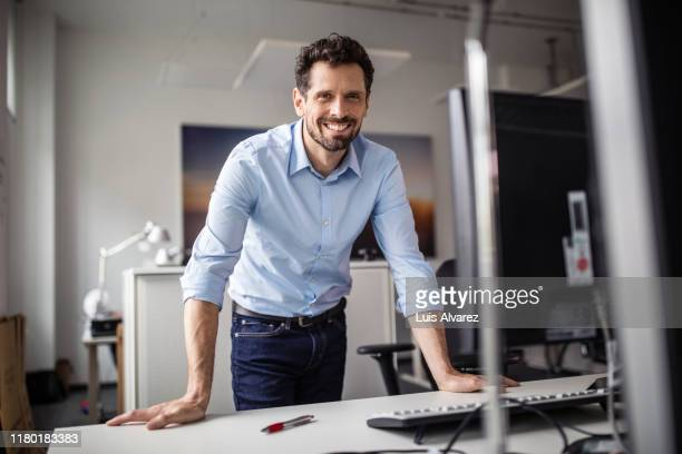 confident businessman in creative office - handsome native american men stock pictures, royalty-free photos & images