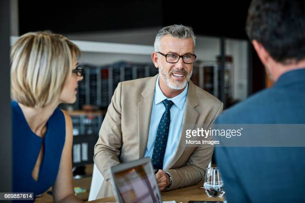 confident businessman looking at colleague - part of a series stock pictures, royalty-free photos & images