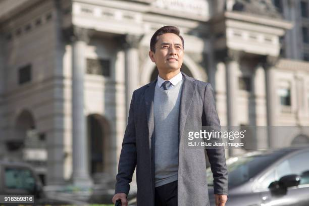 Confident businessman looking at view