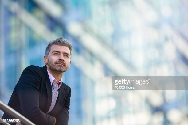 Confident businessman looking over city