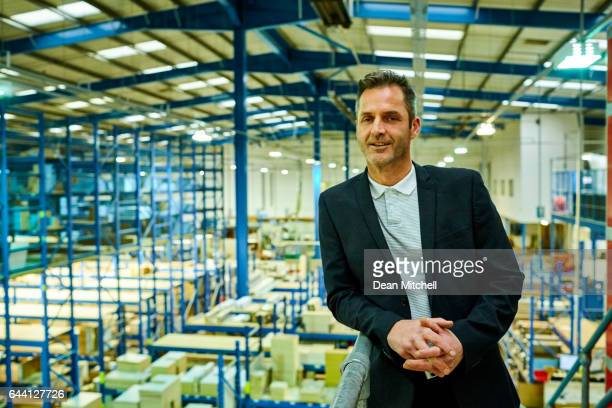 confident businessman on factory balcony - business owner stock photos and pictures
