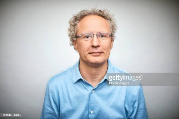 confident businessman on white background - oberhemd stock-fotos und bilder