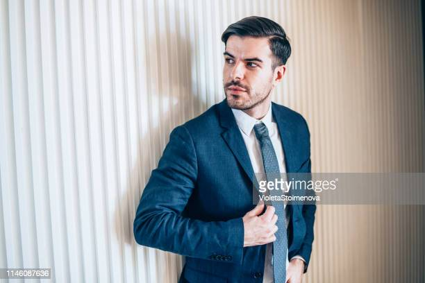 confident businessman - full suit stock pictures, royalty-free photos & images
