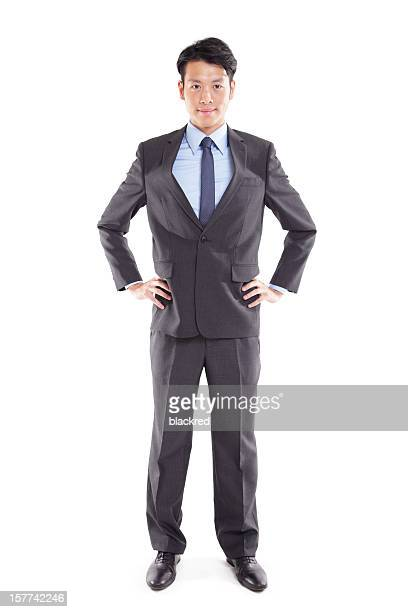 confident businessman - hand on hip stock pictures, royalty-free photos & images