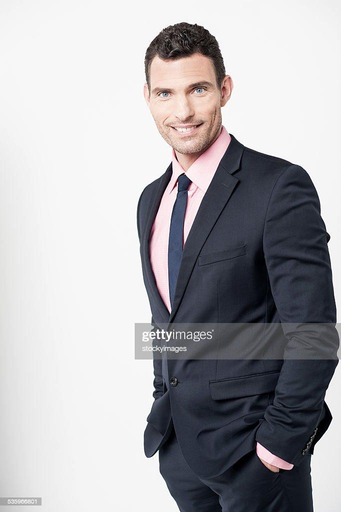 Confident businessman posing over white : Stock Photo