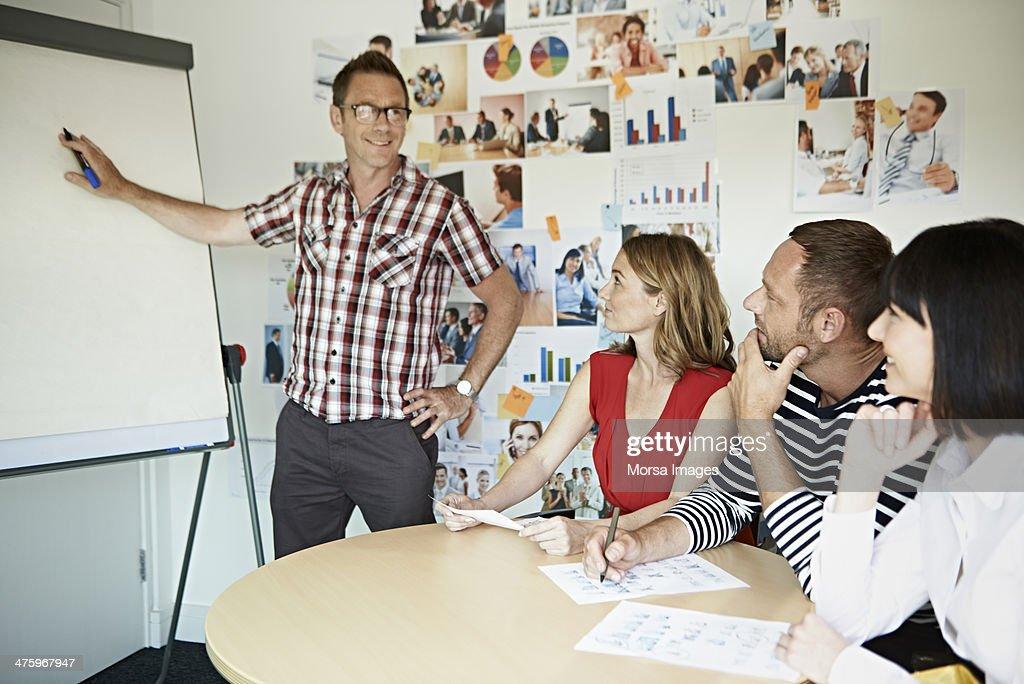 Confident businessman presenting project : Stock Photo