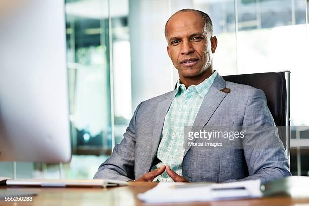 Confident businessman sitting at desk