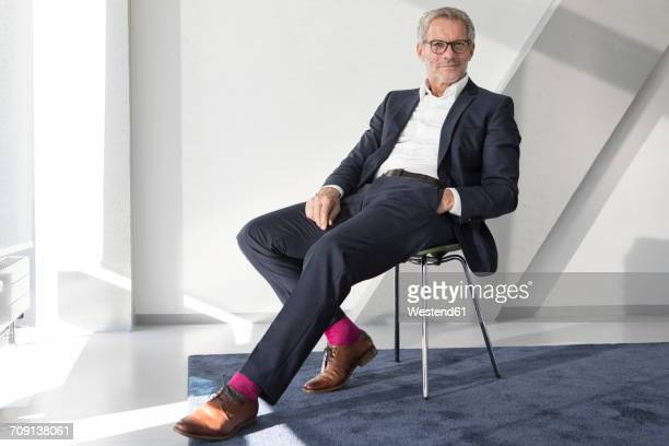Confident businessman sitting on chair