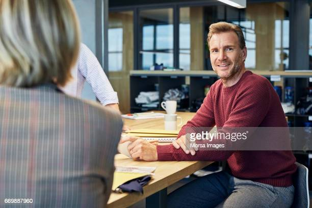 Confident businessman smiling in textile factory