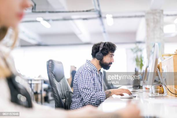 Confident businessman using computer at office