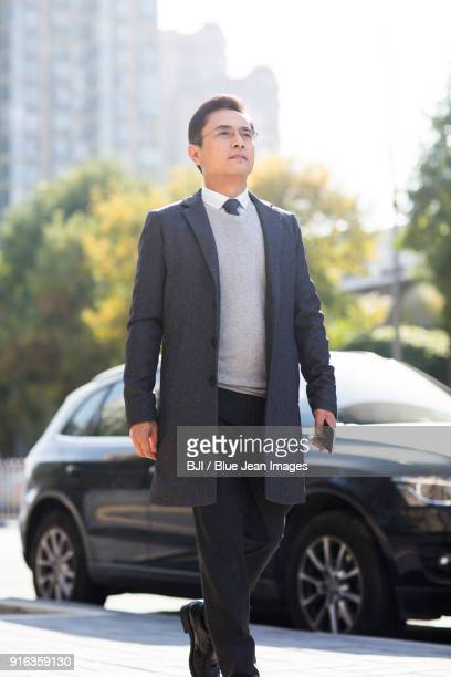 Confident businessman walking