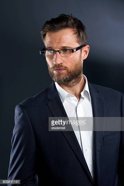 Confident businessman wearing smart glasses