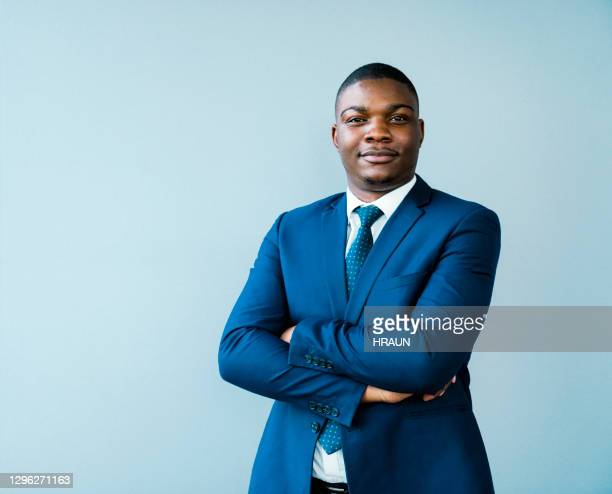 confident businessman with arms crossed - blue suit stock pictures, royalty-free photos & images