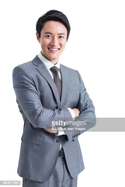 Confident businessman with arms crossed