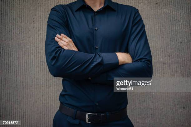 confident businessman with arms crossed - mid section stock photos and pictures
