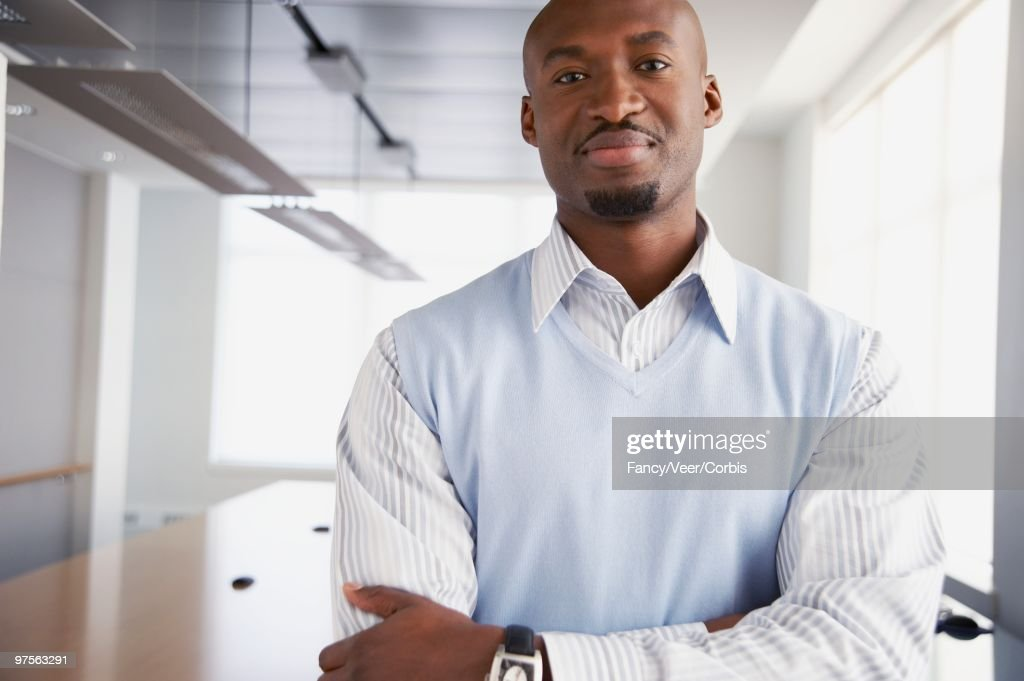 Confident Businessman with Arms Crossed : Stock Photo