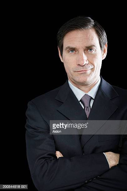 Confident businessman with arms crossed, portrait