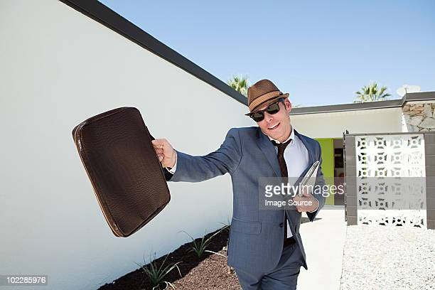 confident businessman with briefcase and trilby - fedora stock pictures, royalty-free photos & images