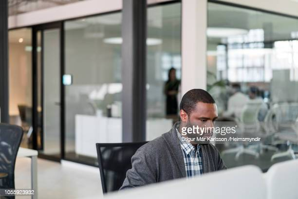 Confident businessman working at desk in office