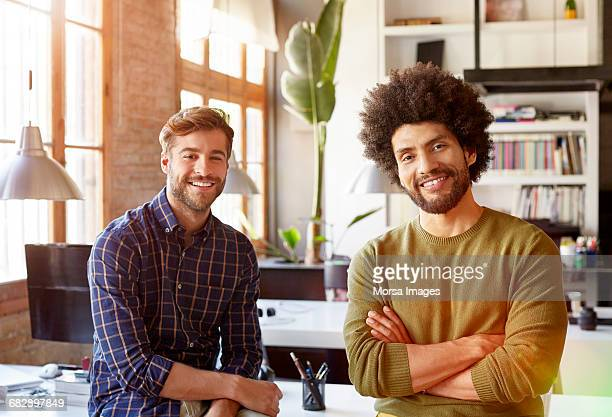 Confident businessmen smiling together in office