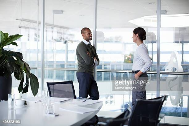 confident businesspeople discussing - distant stock pictures, royalty-free photos & images