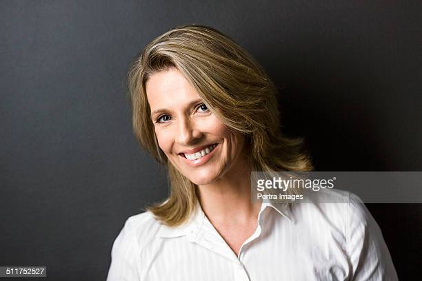 Confident businesswoman against blue background