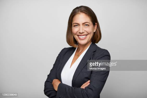 confident businesswoman against white background - businesswoman stock pictures, royalty-free photos & images