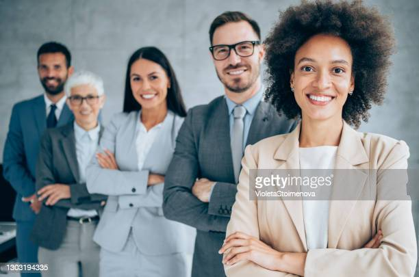 confident businesswoman and her team. - businesswear stock pictures, royalty-free photos & images