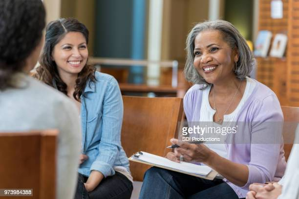 confident businesswoman brainstorms with colleagues - old university stock pictures, royalty-free photos & images