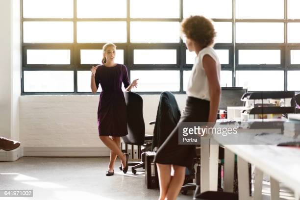 Confident businesswoman discussing with colleague