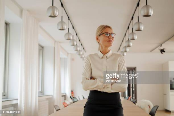confident businesswoman in conference room - pbs stock pictures, royalty-free photos & images
