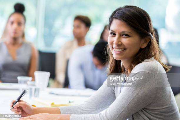 confident businesswoman in meeting - town hall meeting stock pictures, royalty-free photos & images