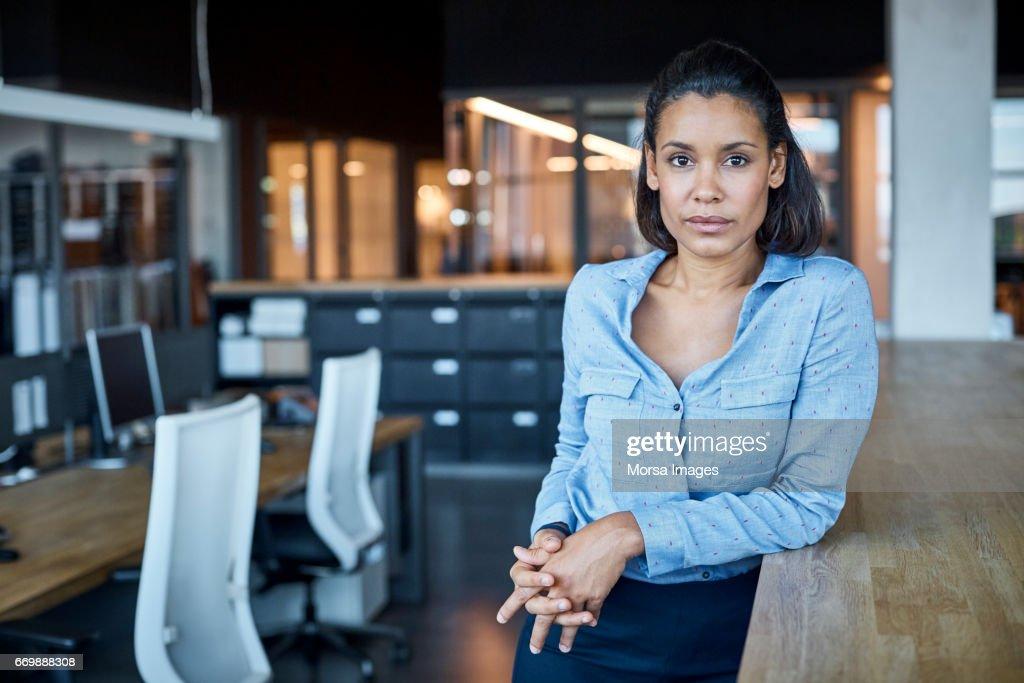 Confident businesswoman in textile factory : Stock Photo