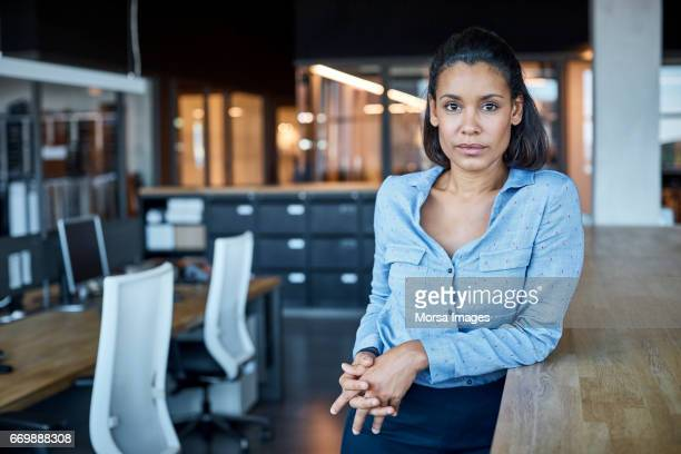 confident businesswoman in textile factory - three quarter front view stock pictures, royalty-free photos & images