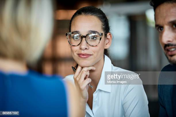 confident businesswoman looking at colleague - differential focus stock pictures, royalty-free photos & images