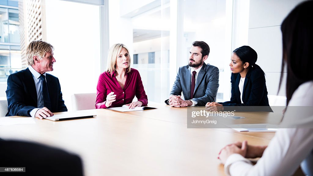 Confident businesswoman making her point in business meeting : Stockfoto