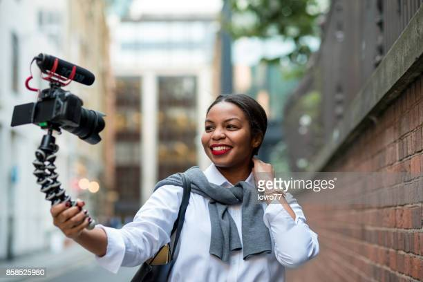 Confident businesswoman making selfie