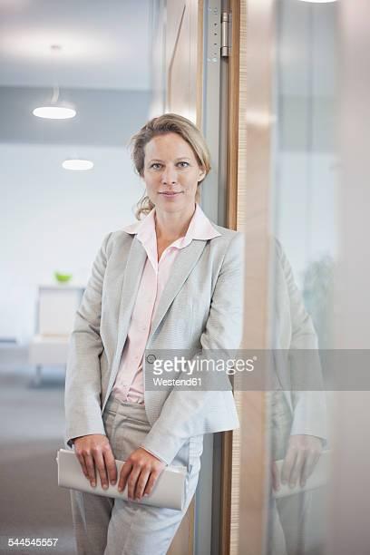 Confident businesswoman on office floor
