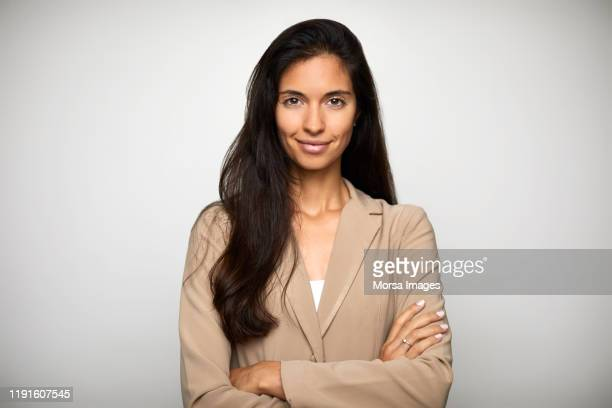 confident businesswoman over white background - beige stock-fotos und bilder