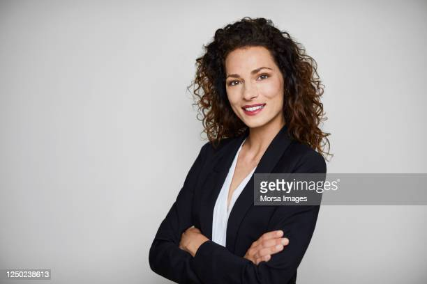 confident businesswoman over white background. - white jacket stock pictures, royalty-free photos & images