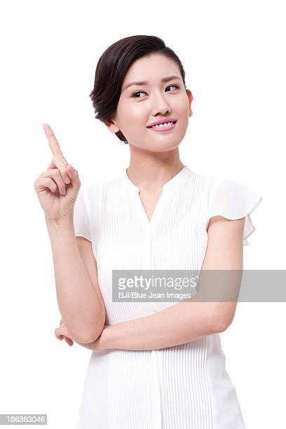 Confident businesswoman raising index finger up