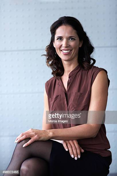 Confident businesswoman sitting in office